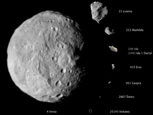 Gray, irregular rocks on black backgrounds, the largest nearly circular.