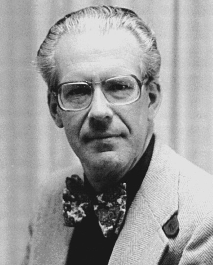 Portrait of older Maarten Schmidt wearing a patterned bow tie and glasses.