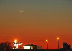 Young moon after sunset, via Dan Bush