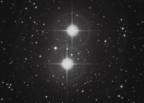 Two brilliant white stars against a star field.