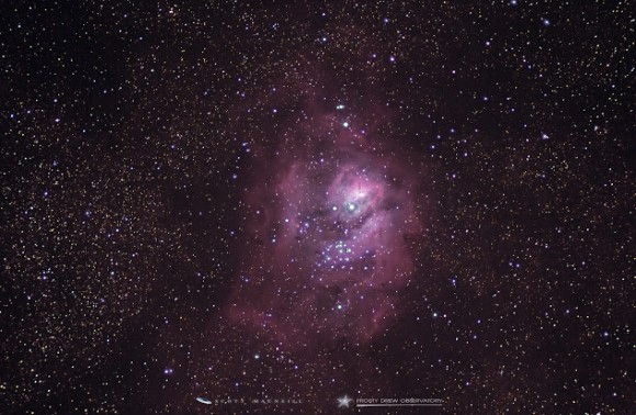 Pink cloud with bright stars in the middle.