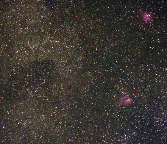 Very dense star field with two small pink patches at top and bottom.