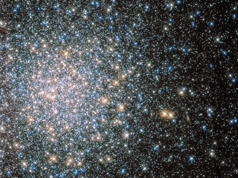 Very densely packed field of multicolored stars, less dense to right.