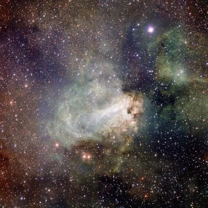 Very dense star field with white, C shaped nebula with a lighter bar across the middle.