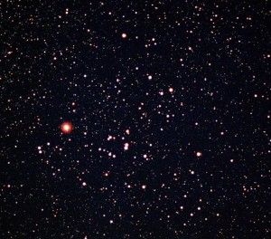V-shaped pattern of stars, with a bright red star at one tip of the V.