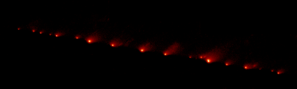 A NASA Hubble Space Telescope image of Comet Shoemaker-Levy 9, taken on May 17, 1994.  At this point, the comet had broken into 21 icy fragments stretched stretched across 1.1 million kilometers (710 thousand miles) of space, or 3 times the distance between Earth and moon.  When this picture was taken, these fragments were on a mid-July collision course with the gas giant planet Jupiter.
