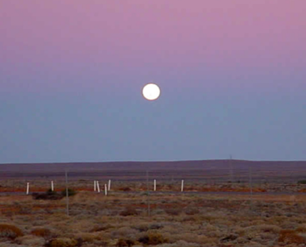 Earth's shadow is the blue-grey band closest to the horizon.  The Belt of Venus is the pink band above the shadow.