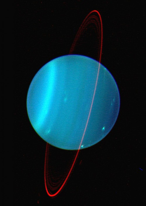 Composite image of Uranus and its faint ring system, by the Keck Telescope at near infrared wavelengths, shows its sideways tilt.  The rings orbit above Uranus' equator.  Image via Lawrence Sromovsky / Keck Observatory.