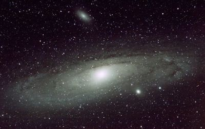 The Andromeda galaxy is the next-nearest large spiral galaxy to our Milky Way. You see it here with 2 of its satellite galaxies.