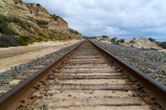 Looking along a pair of railroad tracks viewed from close to the ground.