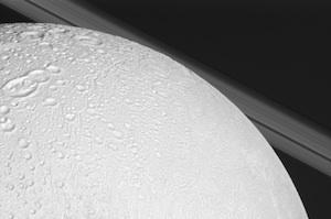 Looking over Enceladus, the frozen moon of Saturn.