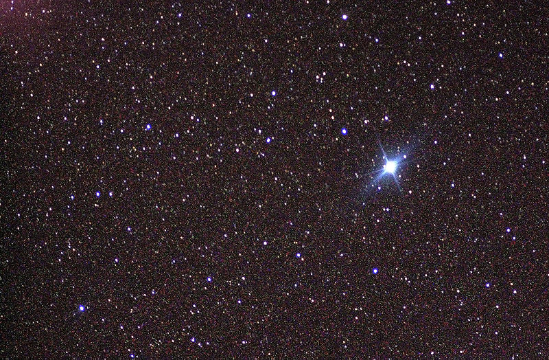 Very rich star field with brilliant white star to one side.