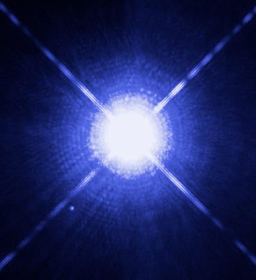 Large, bright star with four rays and much smaller star near it.