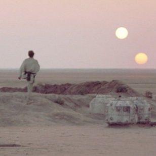 Luke Skywalker watching double sunset on Tattooine from Star Wars