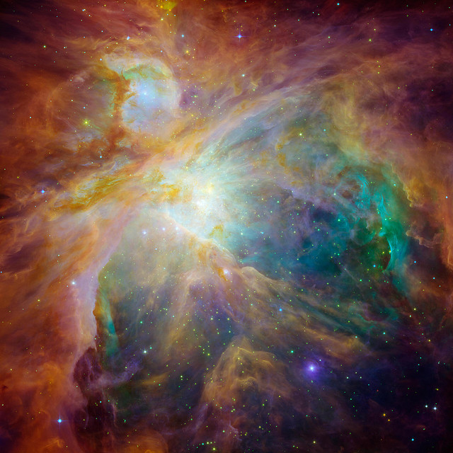Detailed many-colored nebula with scattered stars.