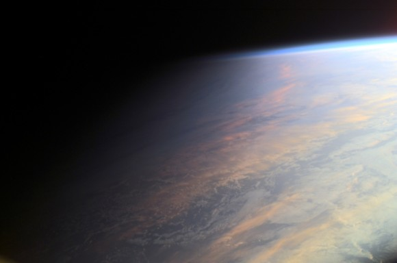 This image of twilight on Earth viewed from space is a single digital photograph from June of 2001 via the International Space Station orbiting at an altitude of 211 nautical miles.  The sun illuminates the scene from the right.  The cloud tops reflect gently reddened sunlight filtered through the dusty troposphere, the lowest layer of the planet's nurturing atmosphere.  It was the Astronomy Picture of the Day for April 6, 2013, which wrote,