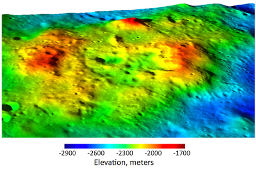 Dome-shaped volcanic features of silica surround what appears to be a caldera on the far side of the moon. NASA composite image from Lunar Reconnaissance Orbiter and digital modeling.