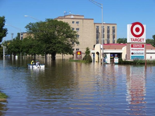 Munster, IN, September 13, 2008.  These residents are boating down a street in Indiana as a result of flooding caused by severe storms which were the remnants of Hurricane Ike. (FEMA)