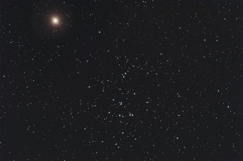Mars was near the star cluster M44 in mid April 2010.  It is the bright reddish object in the upper left of this beautiful image by Peter Wienerroither.  (Used with permission)