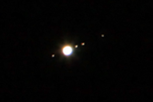 Jupiter and its moons as seen through a telescope on August 15, 2009