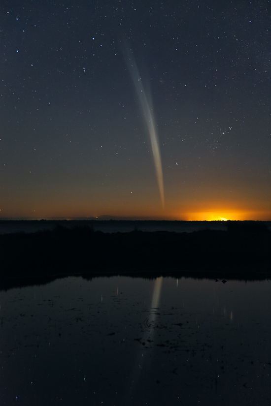Comet Lovejoy reflected in the water of Mandurah Esturary near Perth, on December 21, 2011. Image Credit: Colin Legg.