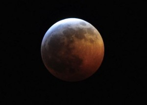 During a total lunar eclipse, the moon looks red.