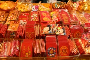 Stacks of envelopes with designs or cartoons on them including Mickey Mouse and Hello Kitty.