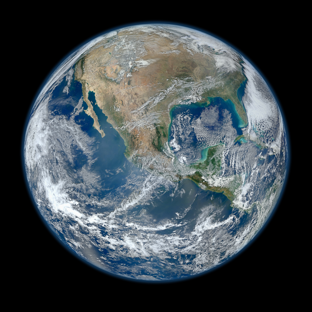 Earth from space with detailed continents, seas, and clouds.