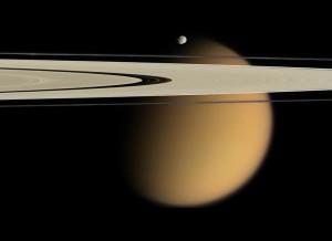 Smog-enshrouded Titan behind Saturn's F-ring. (Cassini)