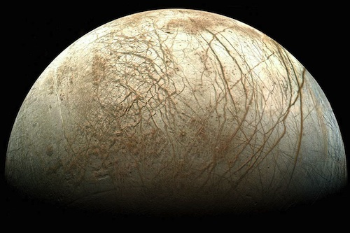 Jupiter's moon Europa, which scientists also suspect might harbor life beneath miles of ice.