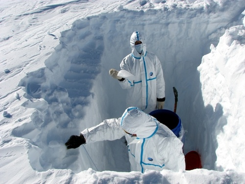 Russian researchers at the Vostok station work in a snow bore pit. (Russian Geographical Society)