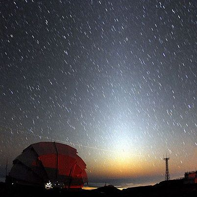 Zodiacal light over the Faulkes Telescope in Hawaii.  Photo by Rob Ratkowksi.
