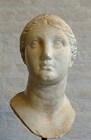 Classical-era marble bust of a woman with short hair.