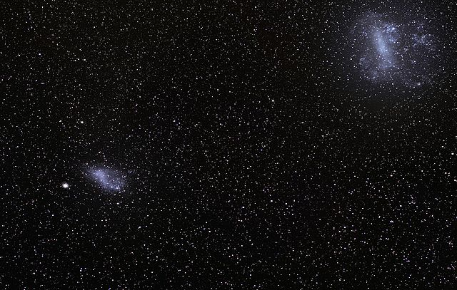 The Magellanic Clouds - satellite galaxies of the Milky Way - dump star building material on to our galaxy via a bridge of hydrogen gas called the Magellanic Stream. Image credit: ESO (via Wikipedia)