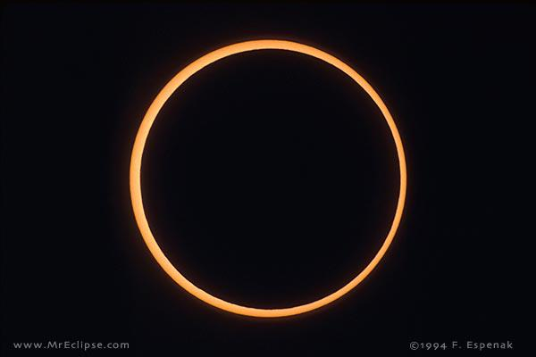 Image copyright Fred Espenak.  Used with permission. During an annular eclipse of the sun, the moon is too far away to completely cover over the solar disk, so an annulus - or ring - of sunshine surrounds the new moon silhouette.