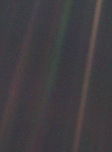 Dim, fuzzy vertical green and brown stripes with tiny dot in one of them.