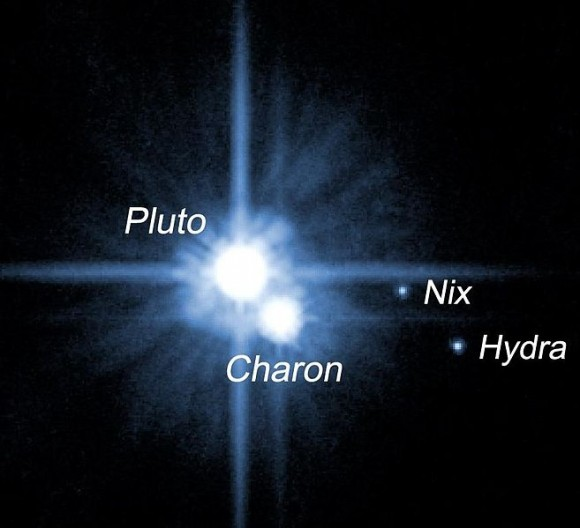 Here is Pluto, with the first three of its known moons.  Astronomers found the largest moon, Charon, in 1978.  They found two more - now called Nix and Hydra - in 2005.  They found a fourth moon in 2011, and now a fifth.