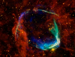 A composite image of supernova remnant, RCW 86.  X-rays are shown in blue and green, infrared light in yellow and red.  The image shows the remains of a supernova that Chinese astronomers saw in 185 A.D.  Located 8000 light-years away in the constellation Circinus, explosion was the result of a white dwarf detonating after a companion star dumped too much material on to it.  The x-ray bubble is now 85 light-years in diameter. X-ray credit: NASA/CXC/SAO & ESA; Infrared credit: NASA/JPL-Caltech/B. Williams (NCSU)
