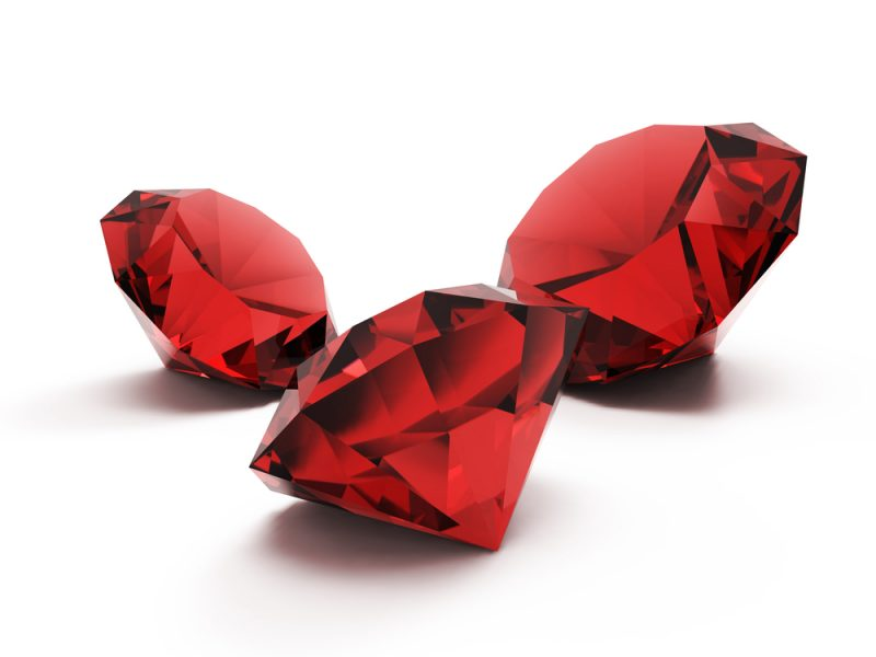 Three large clear red faceted rubies.
