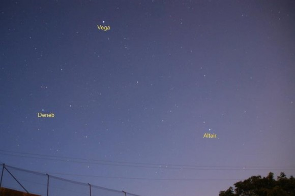 Medium blue sky with a few scattered stars, three bright ones labeled.