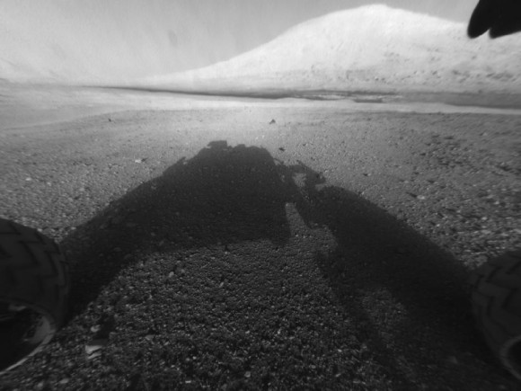 One of the first images from Curiosity of Mars' surface.  Colors images should start coming in later today (August 7).  Here's the shadow of the rover in the foreground, with Mt. Sharp in the background - a destination for the rover in its Mars exploration.  Image Credit: NASA