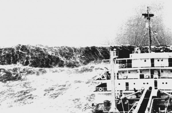 View larger.   Merchant ship in heavy seas as a huge wave looms ahead. Picture taken in the Bay of Biscay near the 100-fathom curve, off France, ca. 1940. Huge waves are common near the Bay of Biscay's 100-fathom line. Published in fall 1993 issue of Mariner's Weather Log. Image via Wikimedia Commons.
