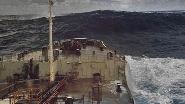 A rogue wave estimated at 18.3 meters (60 feet) in the Gulf Stream off of Charleston, S.C. At the time, surface winds were light at 15 knots. The wave was moving away from the ship after crashing into it moments before this photo was captured. Image and caption via NOAA.