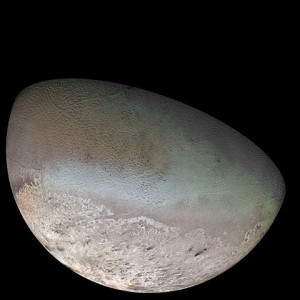 A photomosaic from Voyager 2 of Neptune's largest moon, Triton.  The moon orbits Neptune opposite the direction that the planet rotates.  Does this mean that Triton came from the Kuiper Belt and was eventually captured by the ice giant? Credit: NASA / Jet Propulsion Lab / U.S. Geological Survey