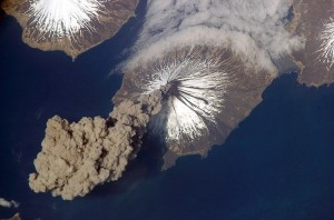 Mount Cleveland releasing ash cloud in 2006, via ISS.