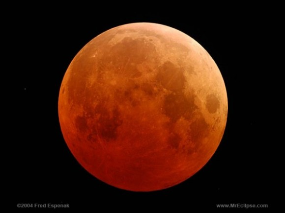 This is what a total eclipse looks like - a reddish, dark orange moon.