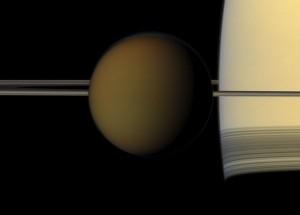 Moon Titan in front of planet Saturn via Cassini spacecraft