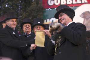 """Dignitaries from the Groundhog Club's """"Inner Circle read Phil's prediction from a scroll."""