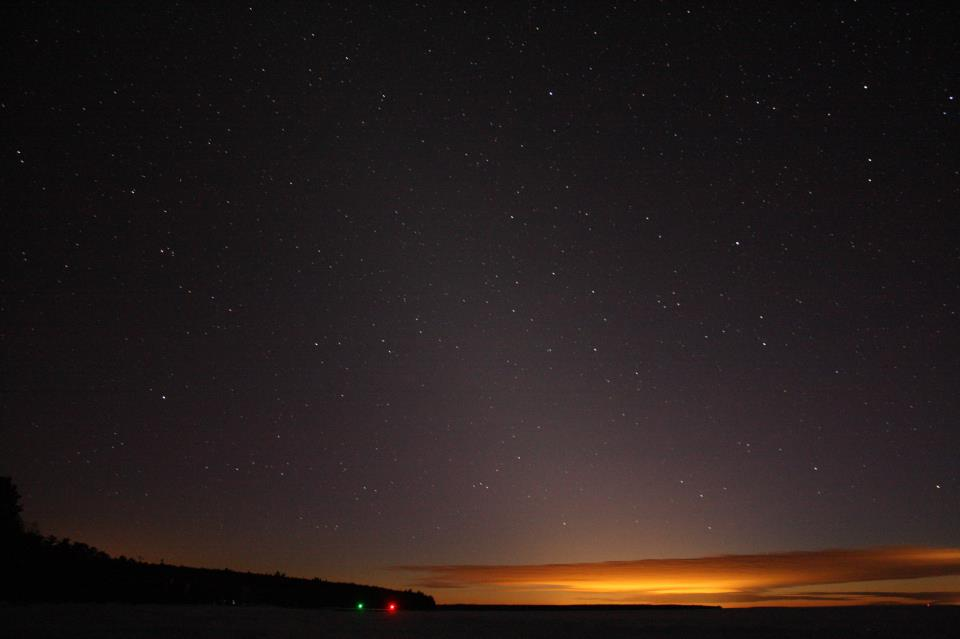 Zodiacal light seen by EarthSky Facebook friend Jim Peacock on the evening of February 5, 2013, over Lake Superior in northern Wisconsin.  You can also see the Circlet of Pisces to the lower right of center - and the Y-shaped Water Jar of the constellation Aquarius to the lower right of the Circlet, just above the sunlit cloud.  Thank you, Jim!  View larger.
