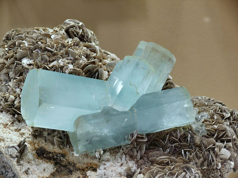 Pale blue oblong hexagonal natural crystals.
